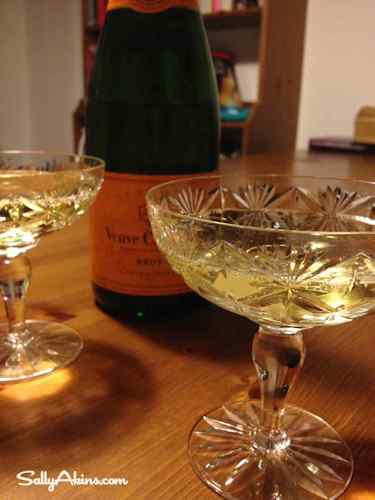 A bottle of Veuve Clicquot champagne with two glasses