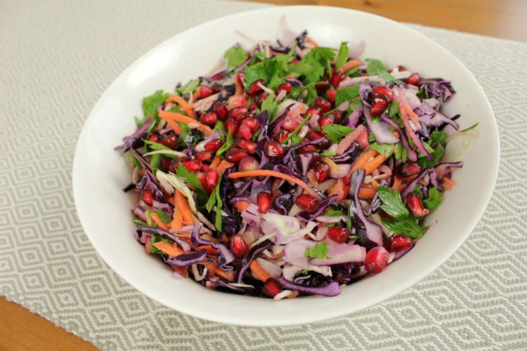 A bowl of sweet and crunchy Winter Slaw with a delicious nutty dressing