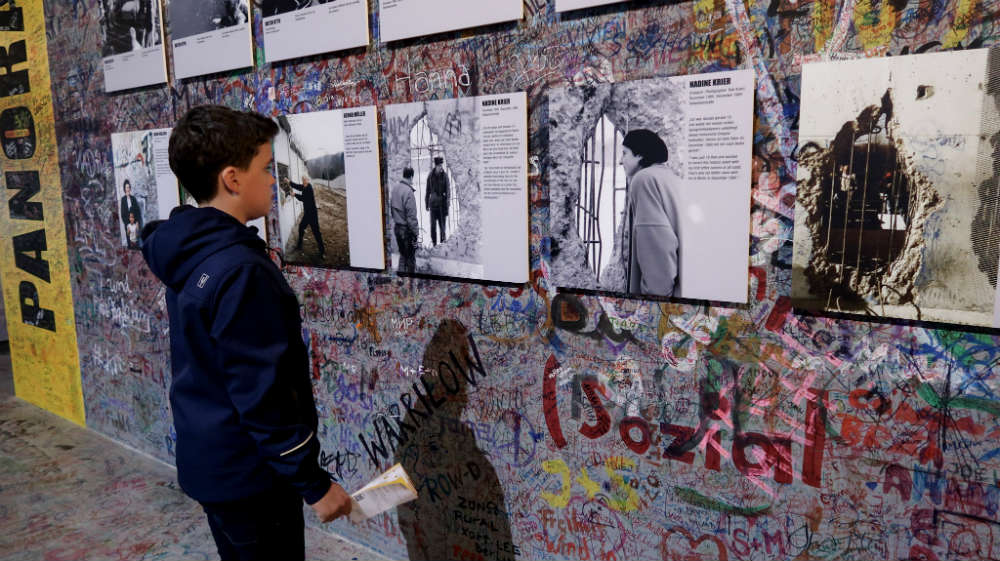 Lyle reading the exhibits at the Berlin Wall panorama exhibition