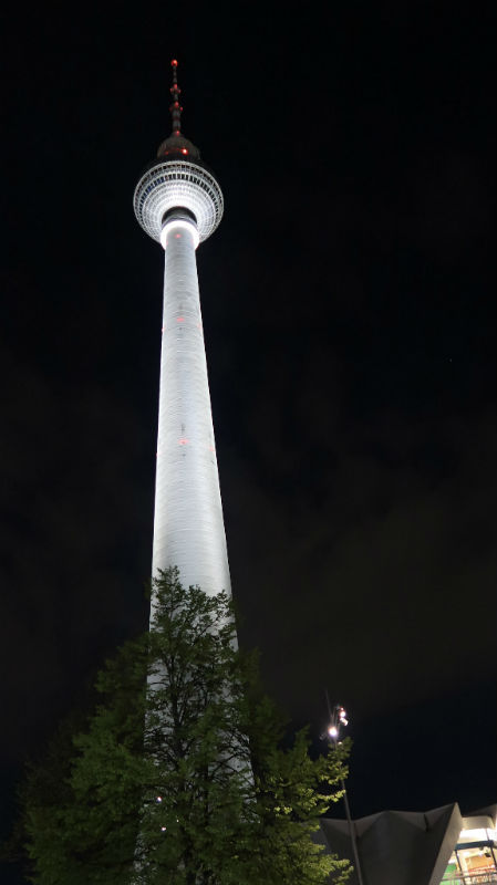 The Berlin TV Tower, or Fernsehturm, lit up at night