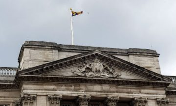 The Royal Standard was flying above Buckingham Palace, showing that the Queen was in residence.
