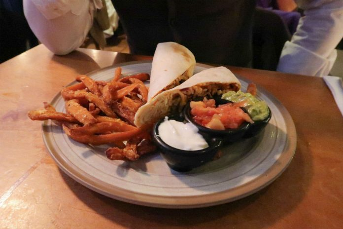 A delicious beef burrito with sweet potato fries at Bodega Cantina restaurant in Birmingham.