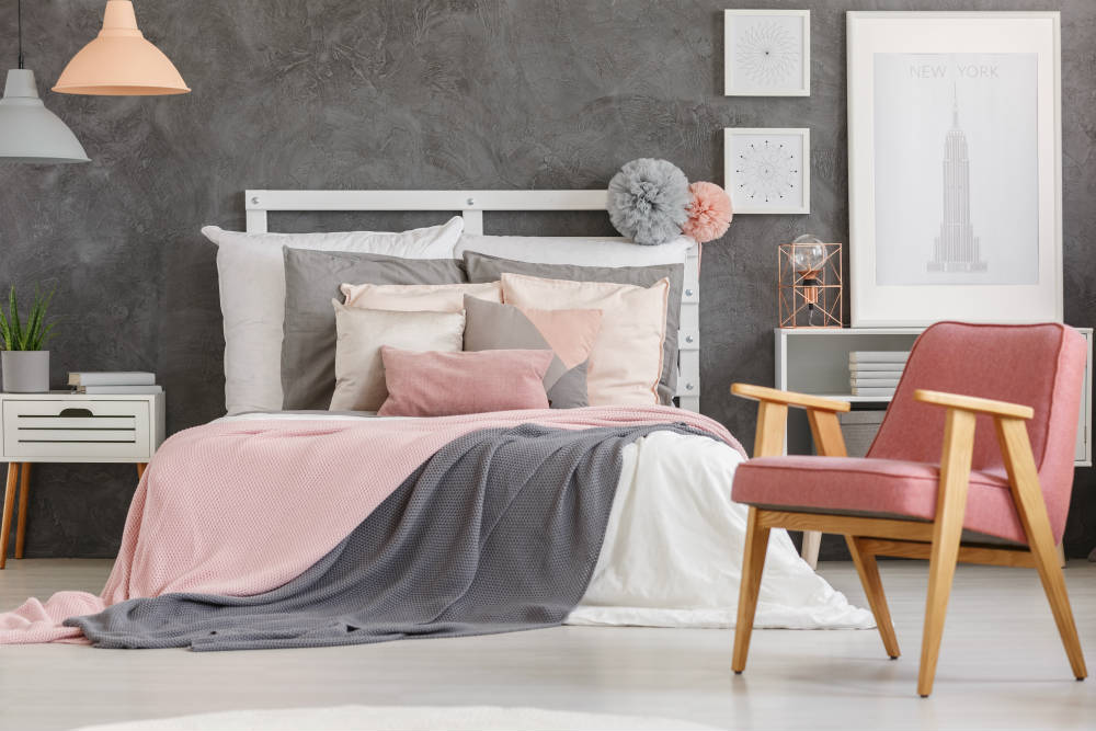 Combining shades of grey and pink give this bedroom a fresh and feminine look
