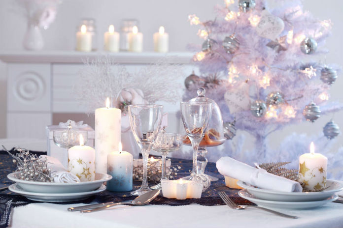 A beautifully decorated table set for Christmas dinner