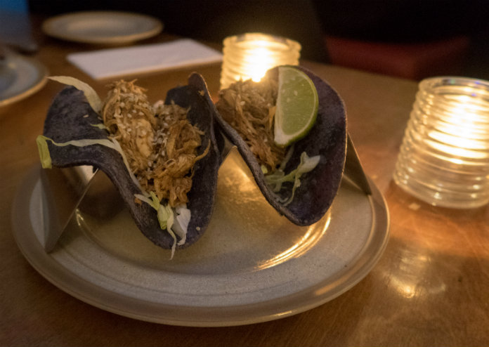 Blue corn tortillas filled with mole chicken at the Bodega Cantina in Birmingham