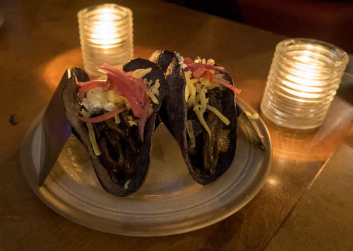 Blue corn tortillas filled with mole mushrooms at the Bodega Cantina in Birmingham