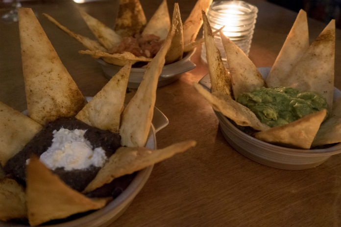 Nacho nibbles topped with salsa, guacamole and refried beans with queso fresco at the Bodega Cantina in Birmingham