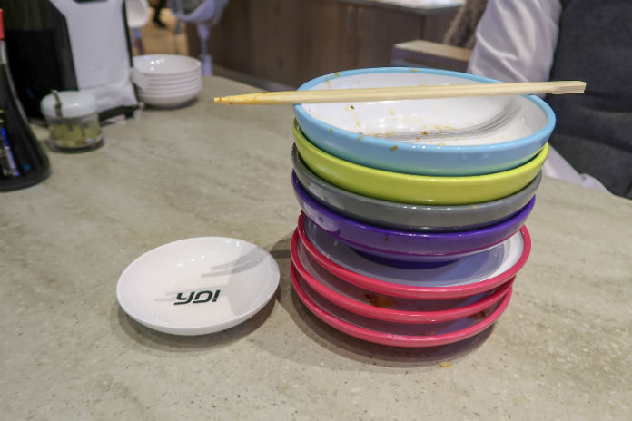 A stack of empty Yo! Sushi plates