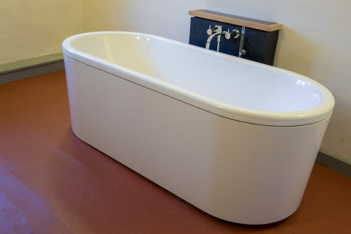 The main bathroom at Castle House, Taunton, Somerset, UK has a standalone bath