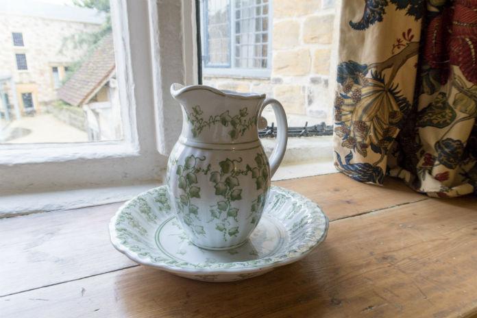 A wash basin and jug at Castle House at Taunton Castle, Taunton, Somerset, UK