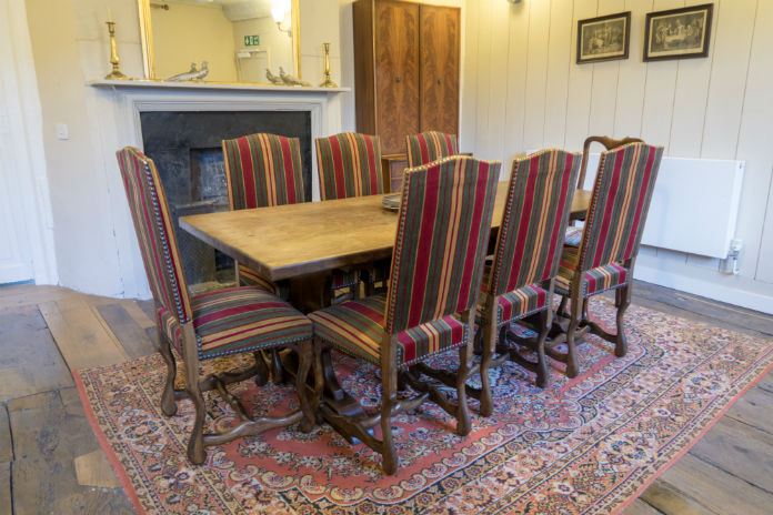 Antique furniture in the dining room at Castle House, Taunton, Somerset, UK
