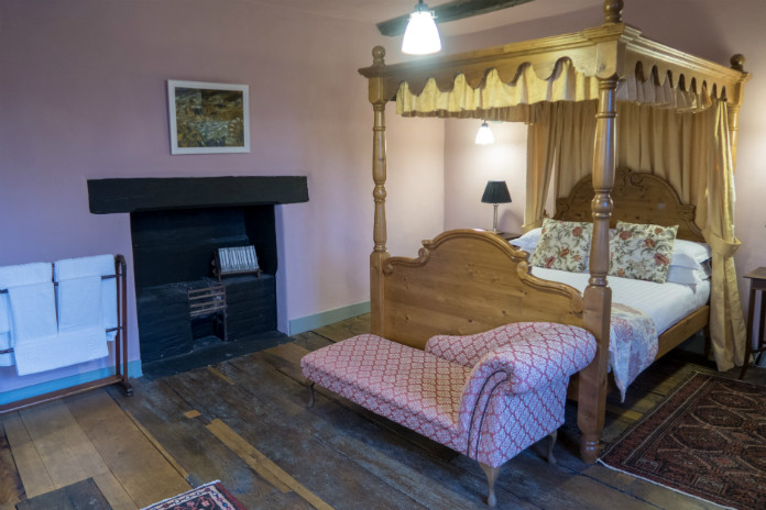 The master bedroom with its four poster bed at Castle House, Taunton, Somerset, UK