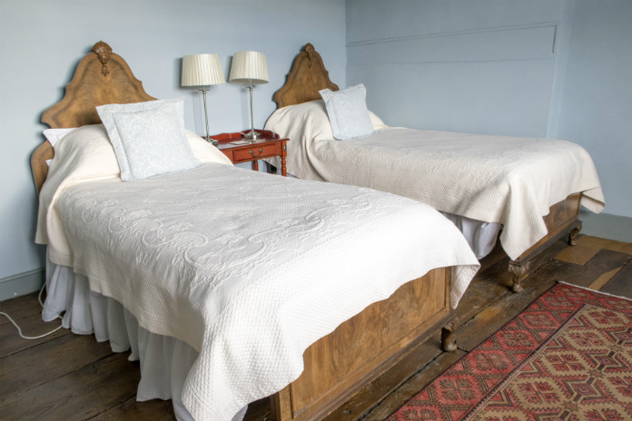 Antique beds in the twin bedroom at Castle House, Taunton, Somerset, UK
