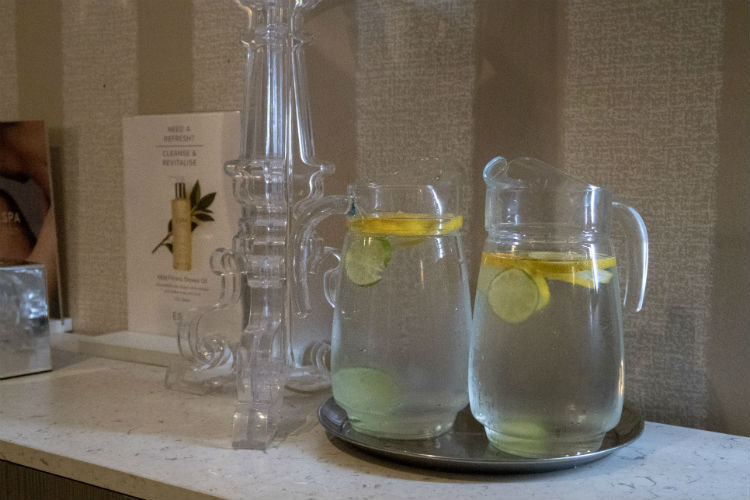 Jugs of chilled water with lemon and lime slices in the relaxation lounge at the Belfry Spa, Warwickshire, UK