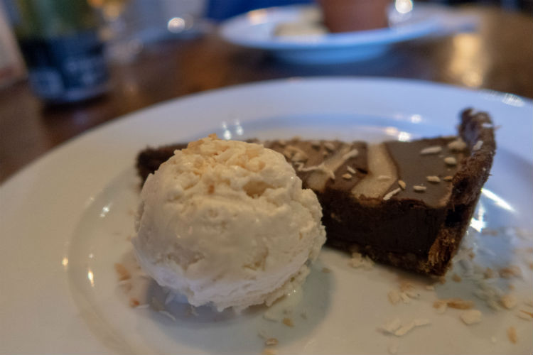 Vegan, gluten-free Chocolate and Coconut Tart and icecream at the Brewhouse & Kitchen in Lichfield, UK