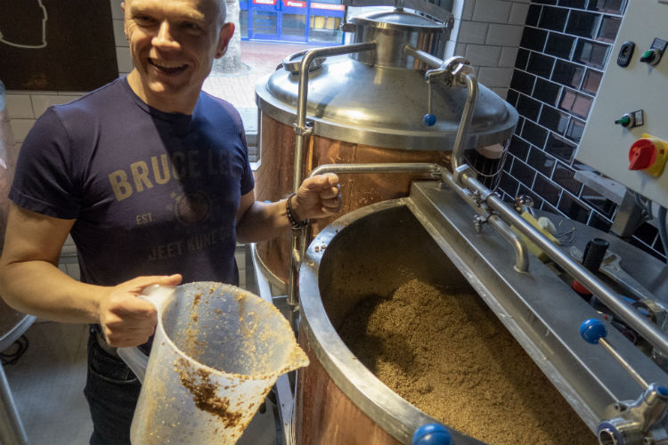 Cleaning out the mash tun at the Brewhouse & Kitchen, Lichfield, UK