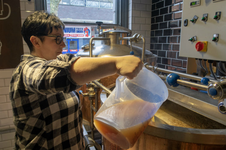 Sally Akins making beer at the Brewhouse & Kitchen, Lichfield, UK