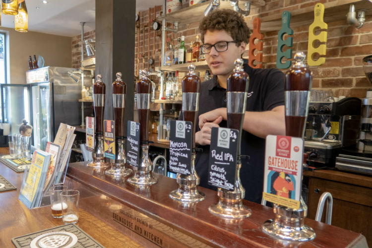 Head brewer Gabriele Vanzo talks through the range of beers at the Brewhouse & Kitchen, Lichfield, UK