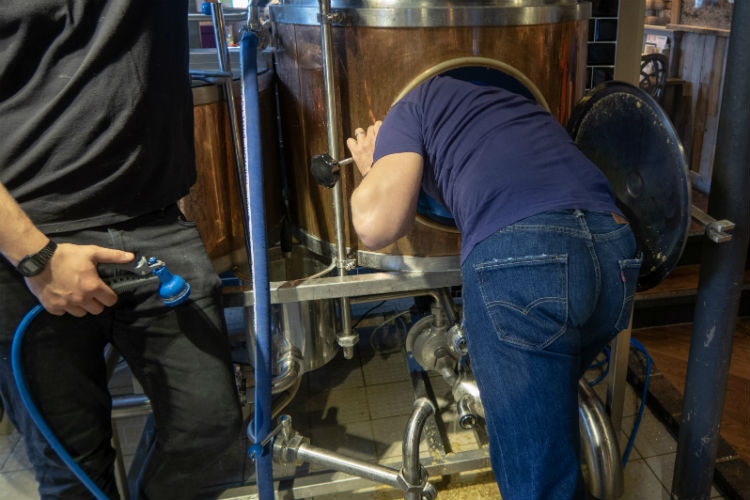 Cleaning out the copper at the Brewhouse & Kitchen, Lichfield, UK