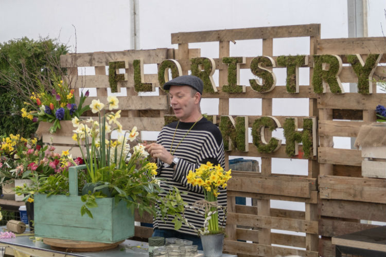 Jonathan Moseley demonstrating flower arranging on the Floristry Bench at the RHS Flower Show Cardiff 2018