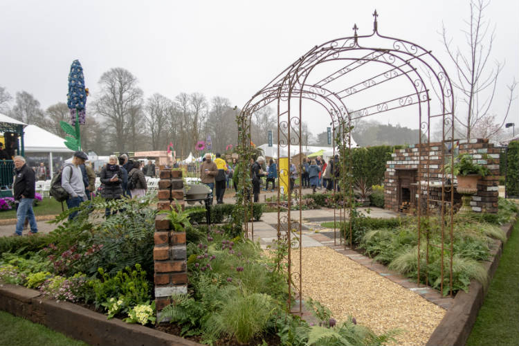 A formal inset parterre and softer planting at the corners of the Reimagined Past Show Garden at RHS Cardiff 2018
