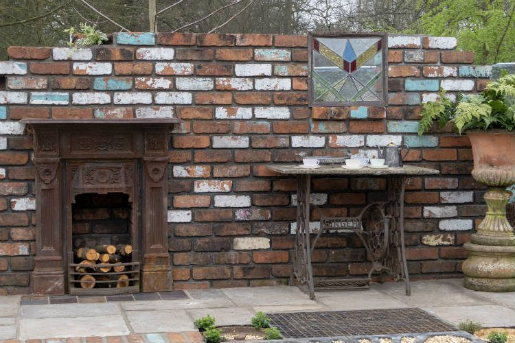 Reclaimed brickwork and an antique Singer trestle in The Reimagined Past - a show garden at RHS Cardiff 2018