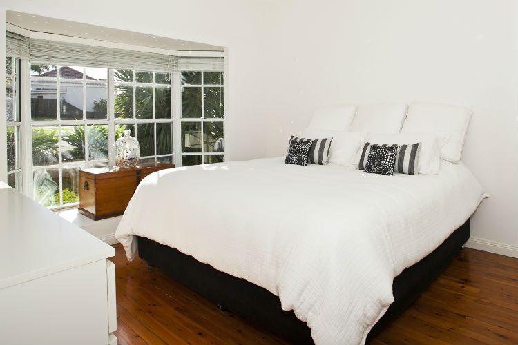 An elegant white bedroom