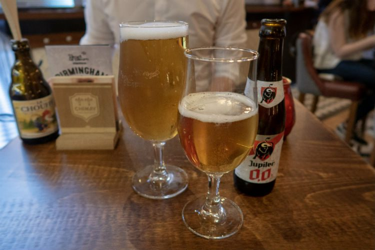 A pint of Hell 'Das Blaue' beer and a bottle of Jupiler 0% lager at the Head of Steam, Birmingham