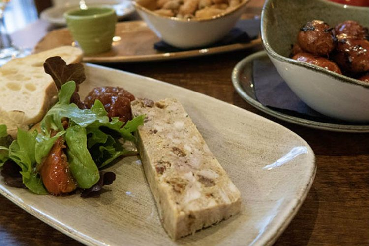 Persian Pressed Chicken served with slices of ciabatta and onion chutey at the Head of Steam, Birmingham