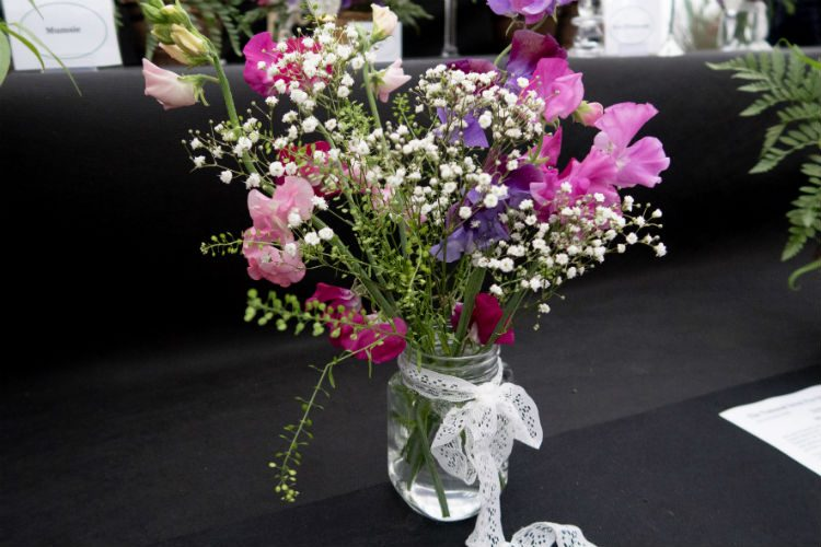 A jam jar displaying a posy of sweet peas at the RHS Malvern Spring Festival 2018