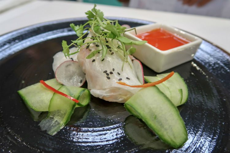 Starter of vegetarian spring rolls with salad and sweet chilli sauce