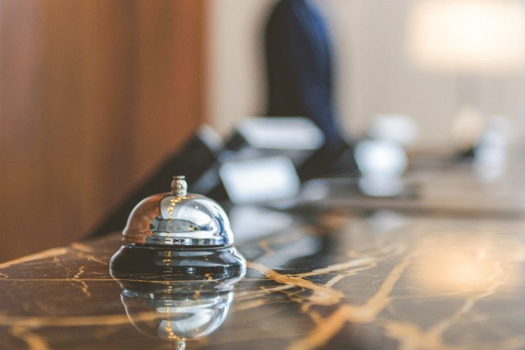 The concierge bell in a stylish hotel lobby