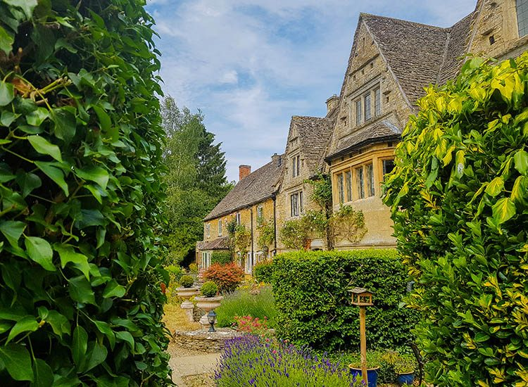 A picture postcard perfect scene in the Cotswolds village of Bourton on the Water