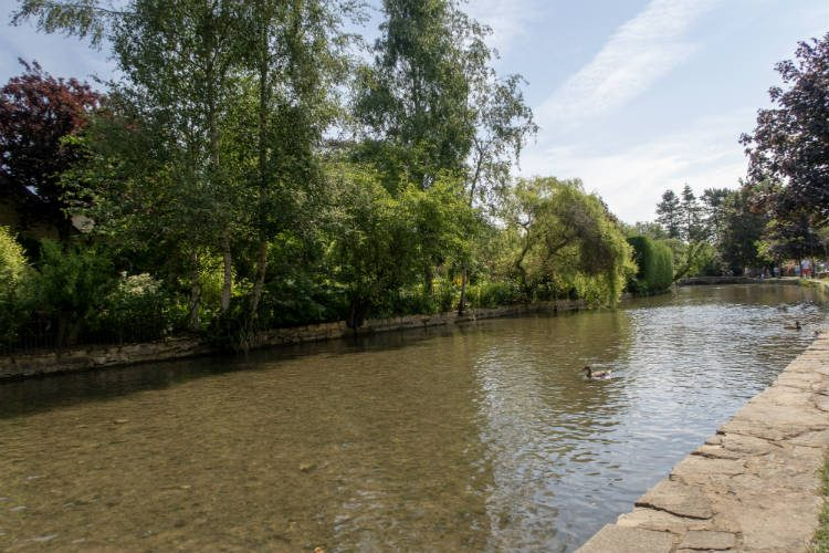 The River Windrush flowing through the Cotswolds village of Bourton-on-the-Water