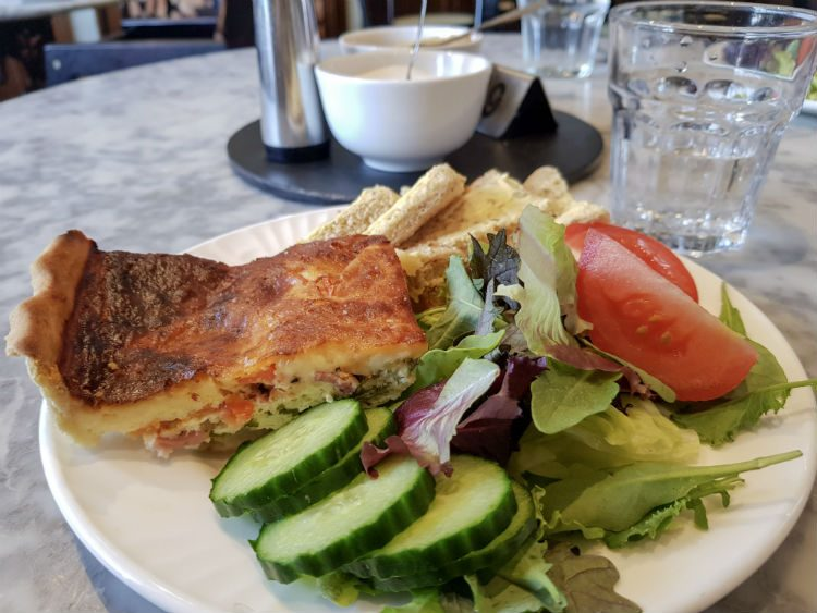 Homemade quiche and salad for lunch in the Tisanes tearoom in Broadway, Cotswolds