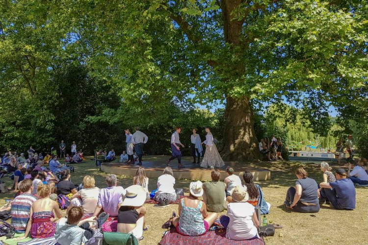 An outdoor production of'Much Ado About Nothing' in Stratford upon Avon