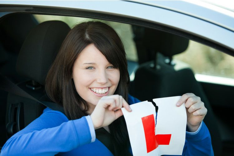A new driver tearing up the L Plates after passing her test.