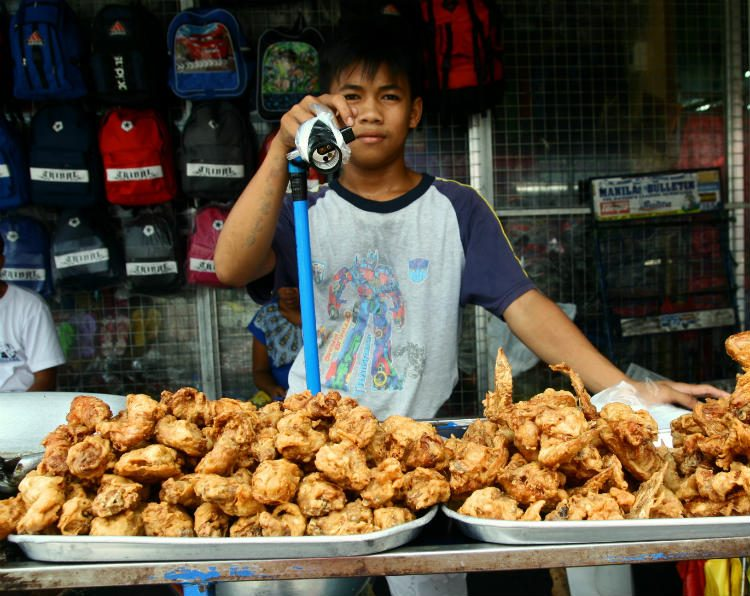 A street vendor selling fried chicken in Antipolo City, Philippines