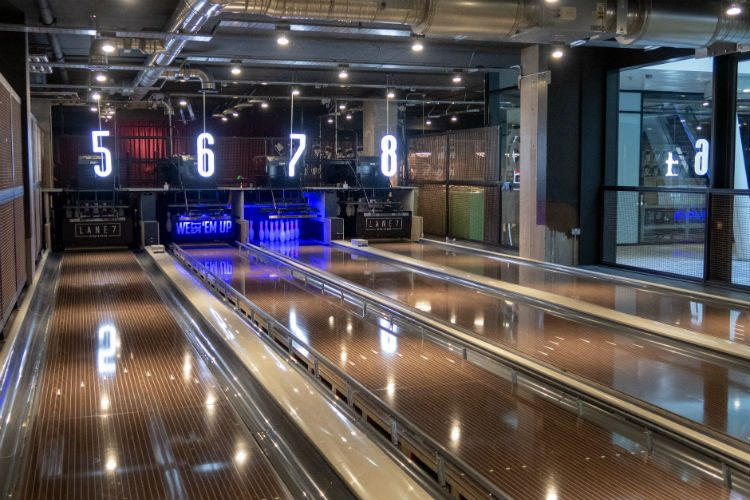 Boutique bowling at Lane 7 Birmingham, with walnut bowling lanes and industrial decor