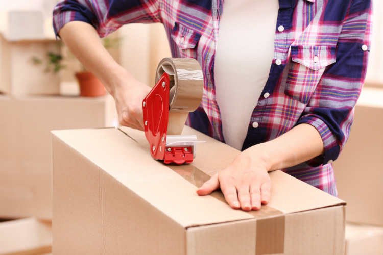 A woman packing up boxes ready for a house move