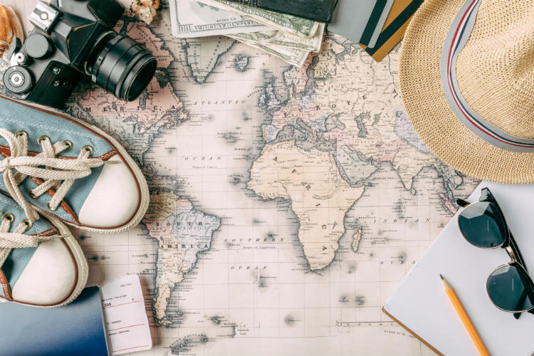 Travel planning with a map, passport, wallet and sunglasses