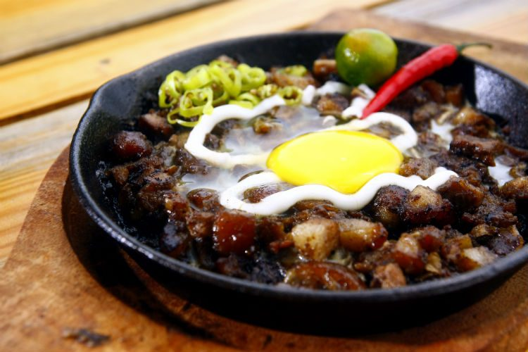 A sizzling plate of Pork Sisig, a popular Filipino dish