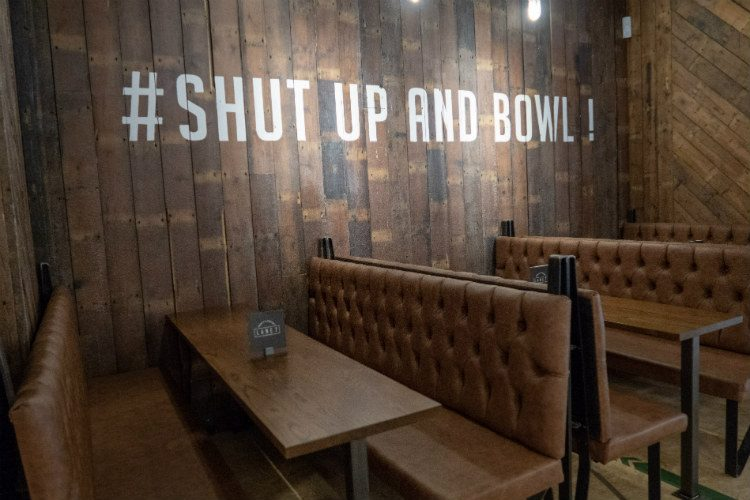 A booth at Lane 7 Bowling Alley, Birmingham, with the words'Shut up and Bowl' painted on the wall