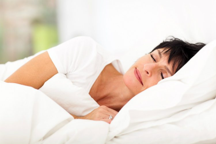 A woman sleeps under a lightweight summer duvet
