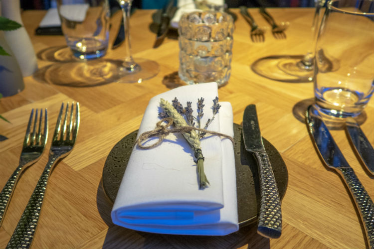 A hand tied sprig of dried flowers on the place setting at the Aria restaurant