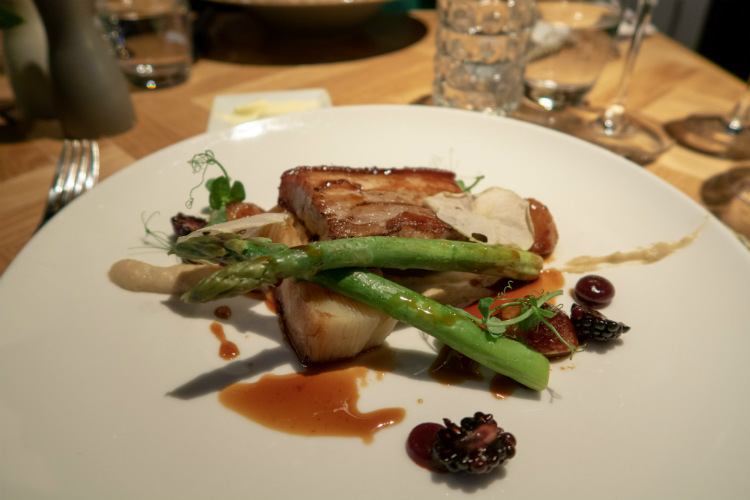 Dingley Dell belly pork, served with dauphinoise potatoes, asparagus, roast cauliflower pure and dired apple pieces at the Hyatt Regency Birmingham, UK
