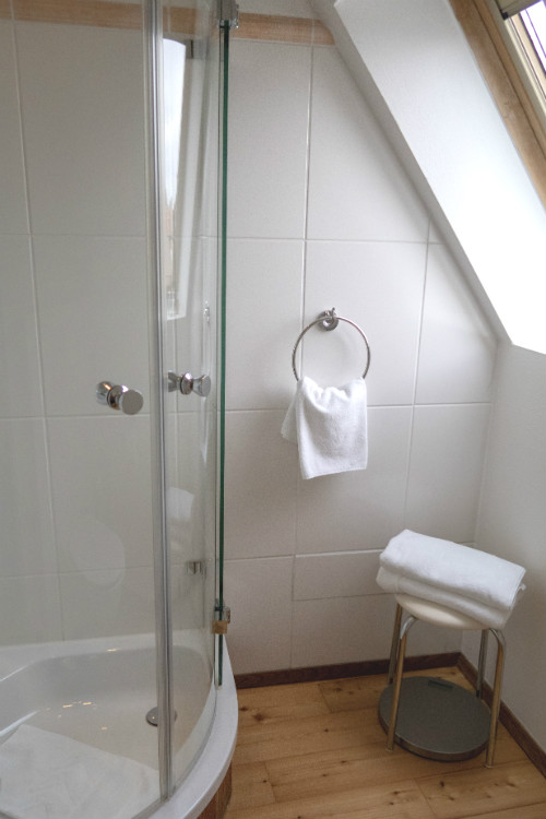 The spotlessly clean shower room in Room 53 at Hotel Drei Raben in Nuremberg, Germany