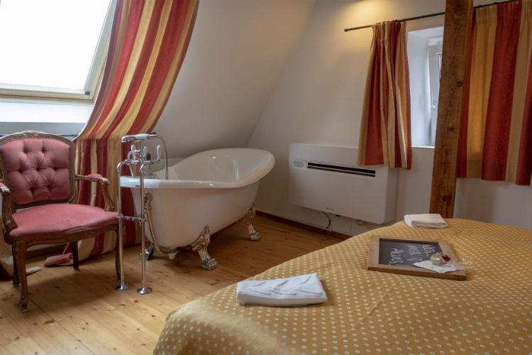 The junior suites at Hotel Drei Raben in Nuremberg all include a roll top bath in the sleeping area.