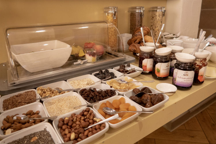 A selection of pastries, jams and toppings for yoghurt on the breakfast table at Hotel Drei Raben in Nuremberg, Germany