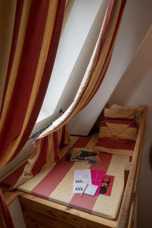 A comfy day bed area overlooking Nuremberg Old Town, at Hotel Drei Raben